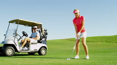 Golf Male Female Caucasian Playing Clubs Green Commercial Sponsor Wealth Leisure Stock Footage