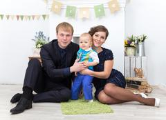Father, mother and one year old toddler boy at home - stock photo