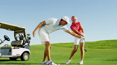 Male Pro Female Caucasian Sport Academy Tuition Game Lifestyle Golf Clubs Green - stock footage