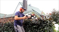 Hedge cutting with engine hedge trimmer, gardening, cutting beech hedge, audio Stock Footage