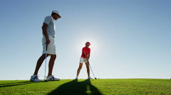 Lifestyle Golf Player Male Female Caucasian Professional Practice Green Sponsor Stock Footage