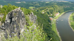 The town of Niederrathen and the Elbe river seen from the Bastei cliffs - stock footage