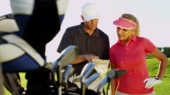 Lifestyle Golf Player Caucasian Couple Successful Practice Green Club Vacation - stock footage