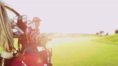 Female Caucasian Golfer Sport Game Lifestyle Golf Clubs Green Outdoors Fairway - stock footage