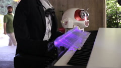 Skull robot playing piano Stock Footage