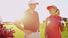 Outdoor Recreation Lifestyle Golf Player Male Female Caucasian Vacation Portrait Stock Footage