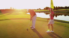 Lifestyle Golf Player Caucasian Couple Putt Target Green Club Florida Vacation Stock Footage