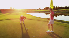 Male Female Caucasian Sport Game Precision Golf Clubs Outdoors Flag Hole Ball - stock footage