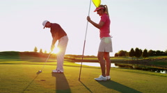 Lifestyle Golf Player Caucasian Couple Putt Target Green Club Florida Vacation - stock footage