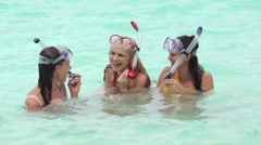 Group Of Girl Friends Lauging In Water Wearing Scuba Masks Stock Footage