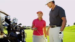 Male Female Caucasian Game Lifestyle Golf Clubs Green Outdoors Fairway - stock footage