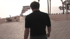 Young Man Walks to Swim in the Dead Sea Stock Footage
