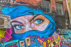 Melbourne graffiti blue eyes women - stock photo