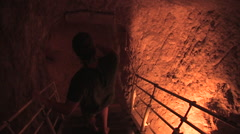 Young Man Wades through Hezekiah's Tunnel under Ir David, in Jerusalem, Israel Stock Footage