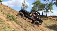 Footage of black off road car in the terrain Stock Footage