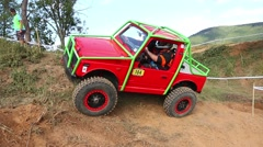 Footage of red off road car is terrain Stock Footage