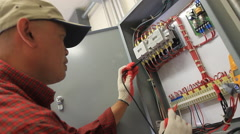 Electrician works on a Project - stock footage