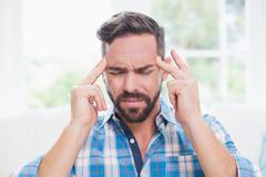 Ill man suffering from headache Stock Photos