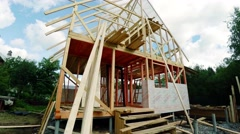 The frame of the wooden house. Building. 4K - stock footage