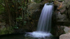 Man-made cascading waterfall in the park. A slow shutter speed. Stock Footage