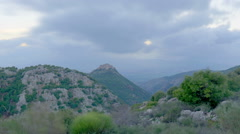 Panning shot of Dusk time-lapse of the hills near Nimrod, Israel Stock Footage