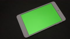 Silver green screen tablet  PC on dark wooden surface slow panning 4K 2160p U Stock Footage
