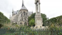 Notre-Dame cathedral located in France capital Paris by the day tilting 4K 21 - stock footage