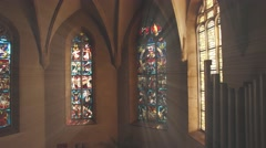 Colour windows in a church with sunshine Stock Footage