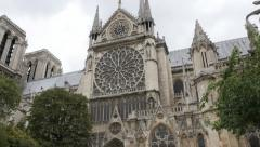 Notre-Dame cathedral located in France capital Paris by the day tilting 4K 21 Stock Footage