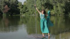 Girl dancing around pylon in nature. - stock footage