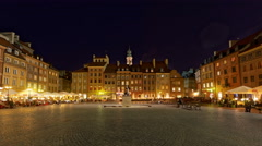 Nightlife in Warsaw: People visit old town marketplace square, Warsaw, Poland Stock Footage