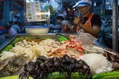 Fish seller in Asian market Stock Photos