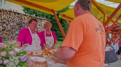 Man is talking about sweets with sellers on fair Stock Footage