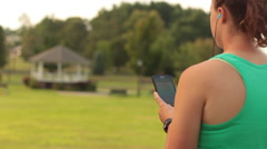 Female Athlete Checking Activity on Smart Phone Stock Footage