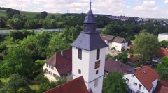 Flight Arround Small Church Tower in German Village Stock Footage