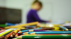 Girl drawing with color pencils Stock Footage