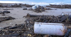 garbage waste water pollution on beach by ocean sea - stock footage