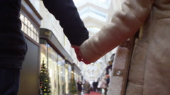 4K Attractive romantic couple shopping together at Christmas time Stock Footage