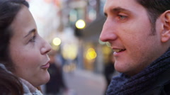 4K Close up of romantic couple kissing on city street at Christmas time Stock Footage