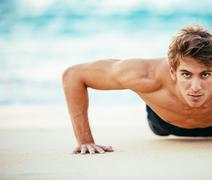 Male Athlete Exercising Doing Push-Ups - stock photo