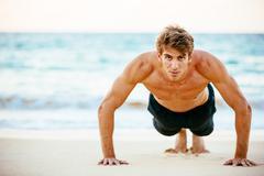 Male Athlete Exercising Doing Push-Ups Stock Photos