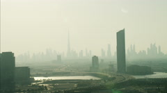 Aerial Dubai city Skyscraper wealth growth UAE Stock Footage