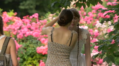 Girl using a mascara in the park, Krakow Stock Footage