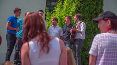 A group of viewers is viewing a group of singers on fair Stock Footage