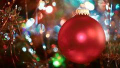 Illuminated Christmas tree with bright red sphere ornament Stock Footage