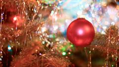 Christmas tree with bright red ornament gradually comes into focus Stock Footage