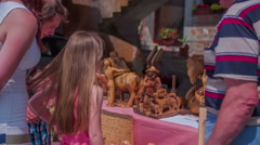 Looking at wooden sculptures on fair Stock Footage