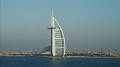 Aerial Burj al Arab 7 star hotel Jumeirah Beach Hotel Dubai UAE Stock Footage