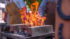 Burning fire in blacksmith workshop on fair Stock Footage