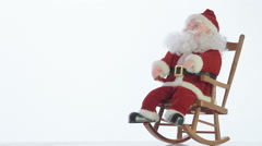 Santa Claus toy rocking in a rocking chair - stock footage